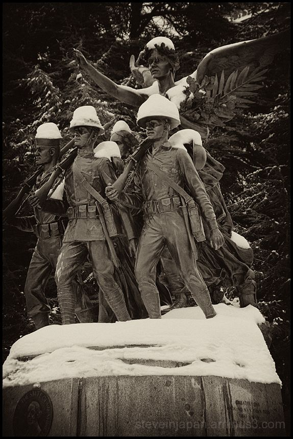 A WWI memorial covered with snow.