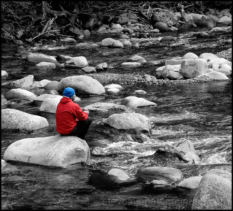 A hiker in the middle of the Wallace River.