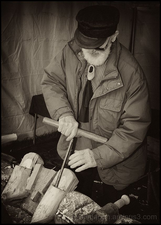 A wooden shoemaker at work.