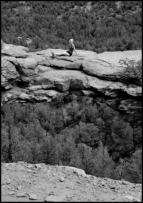 A lady sitting on Devil's Bridge near Sedona.