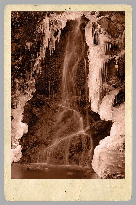 Petite falls wearing an icy shawl.