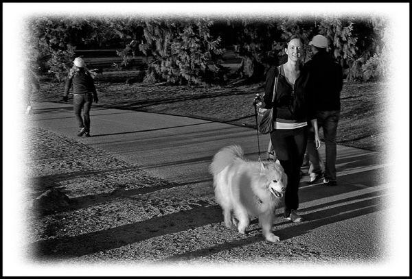 A dog and his mistress at Green Lake.