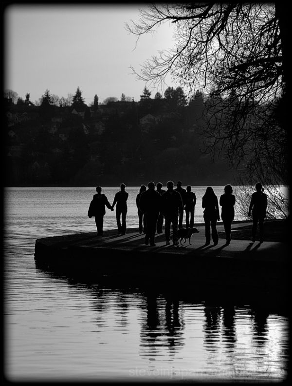 People enjoying the sun at Green Lake.