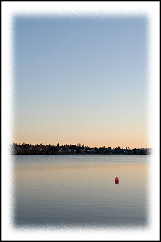 A contrail over Green Lake.