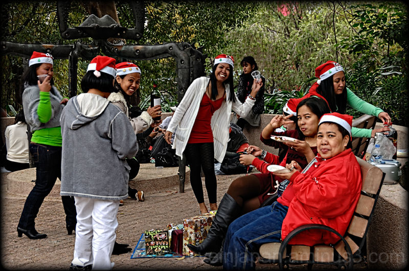 A group of nannies gather in Kowloon Park.