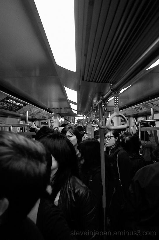 On an MTR train in Hong Kong.
