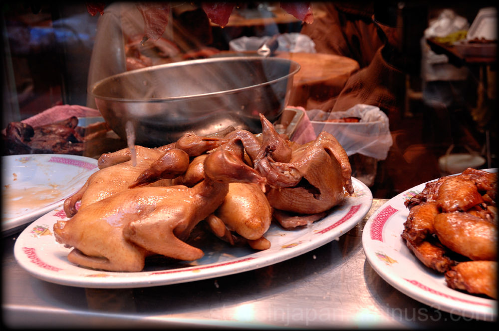 Roast chickens in a Hong Kong restaurant window.
