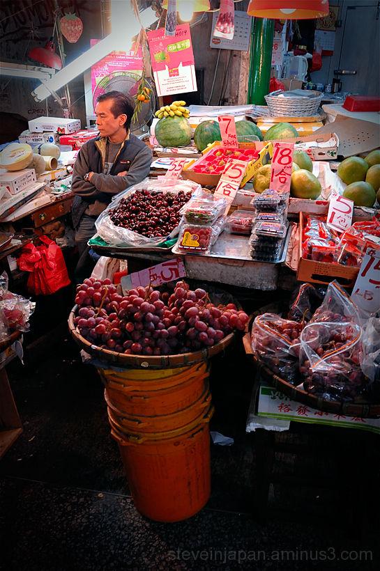 A fruit seller in the Graham Street market.