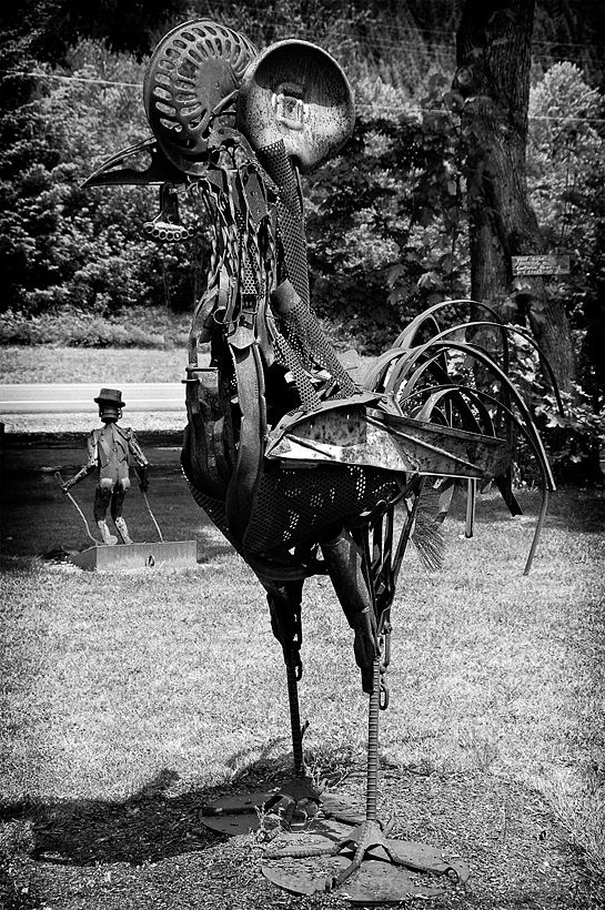 A rooster sculpture made of scrap iron.
