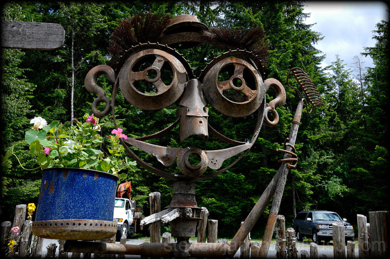 A gardener sculpture made of scrap iron.