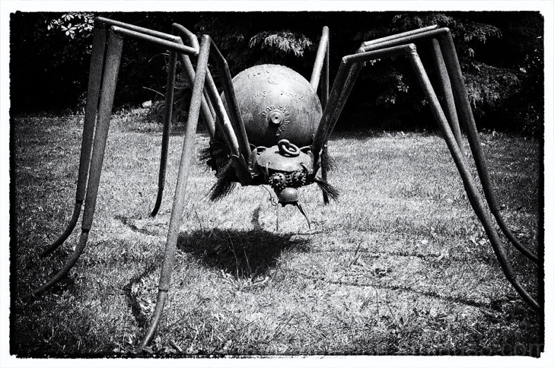 A spider sculpture made of scrap iron.