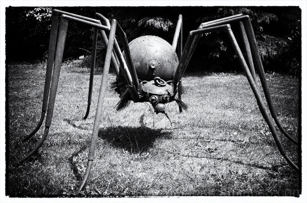 A spider sculpture made of scrap iron.