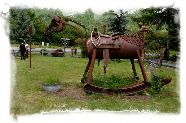 A rocking horse sculpture made of scrap iron.