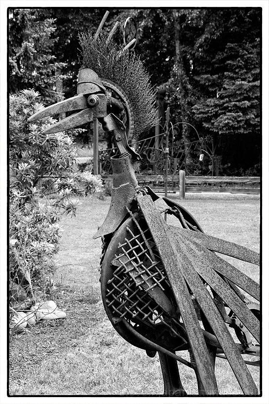 A bird sculpture made of scrap iron.