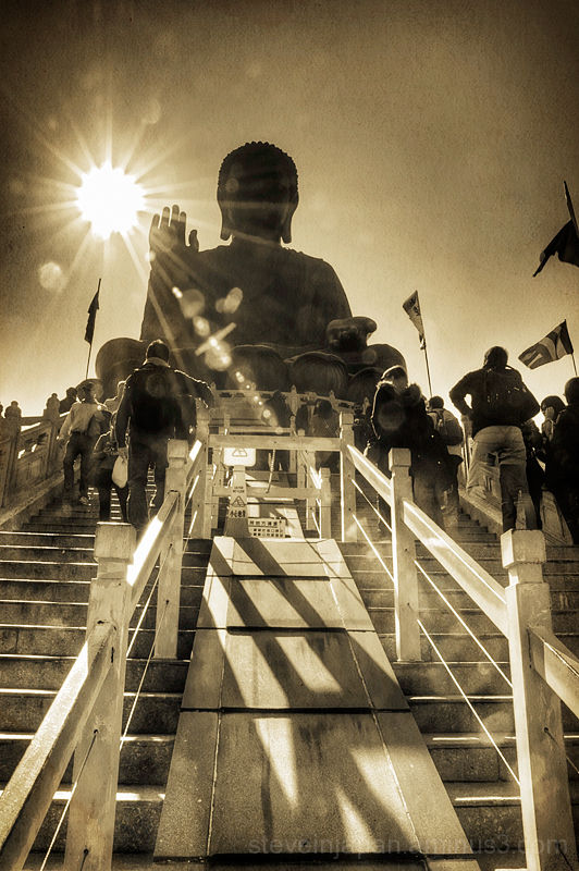 People visit the giant Buddha at Po Lin Monastery.