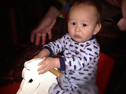 Alexander's first ride on the rocking horse.