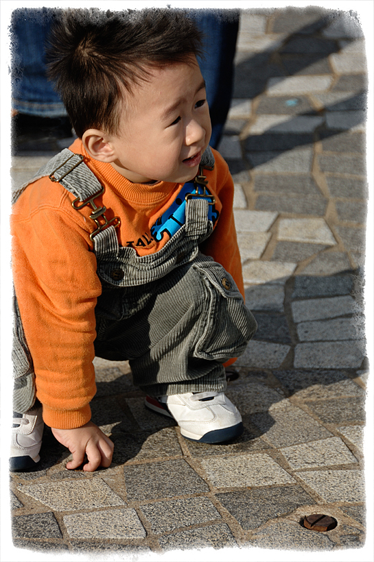 A young boy on the street in Hong Kong.