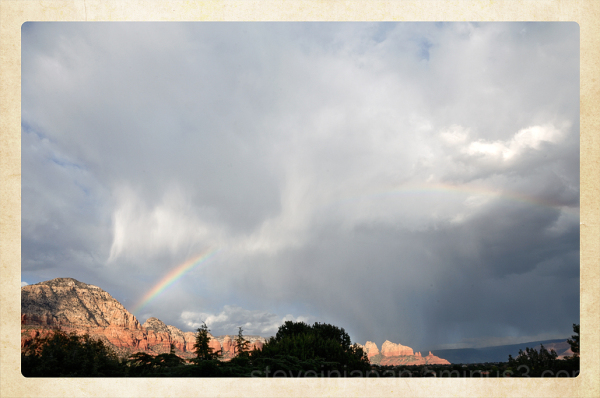 Sail Rock and rainbow in Sedona, Arizona, USA.