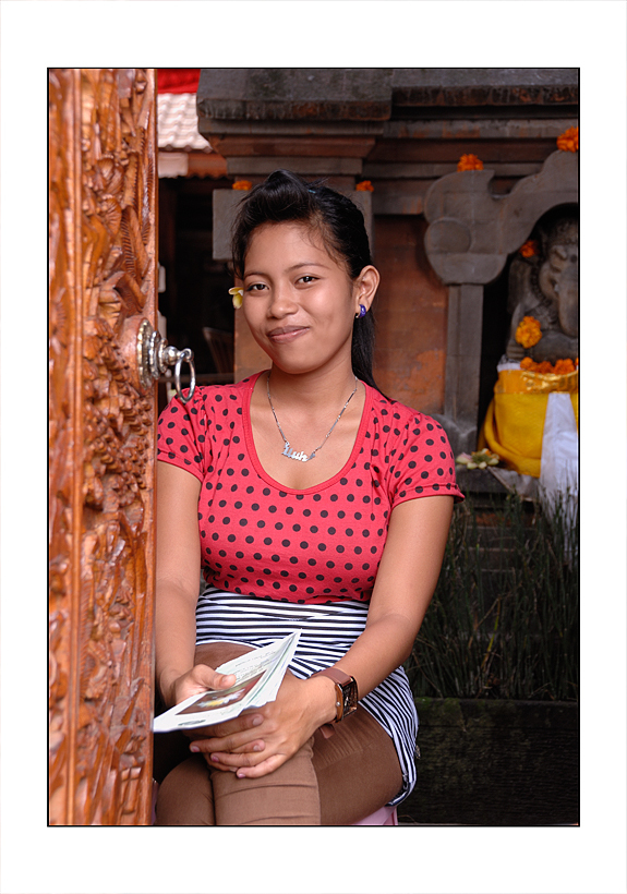 A young lady in a Bali doorway.
