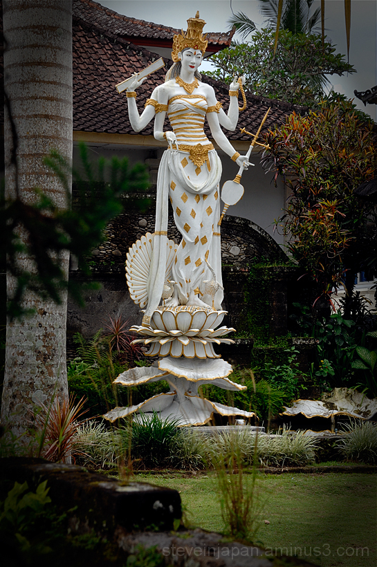 A lovely goddess, along the street, in Ubud.