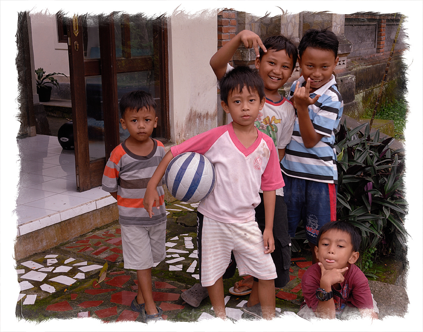 Some boys pose along the street in Ubud.