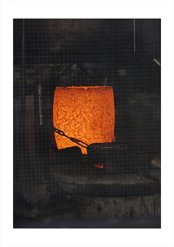 A crucible of molten bronze ready for the pour.