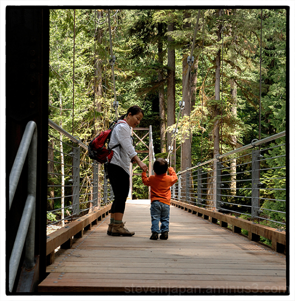Alex and his mom cross the suspension bridge.