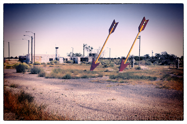 Twin arrows at an abandoned gas station.