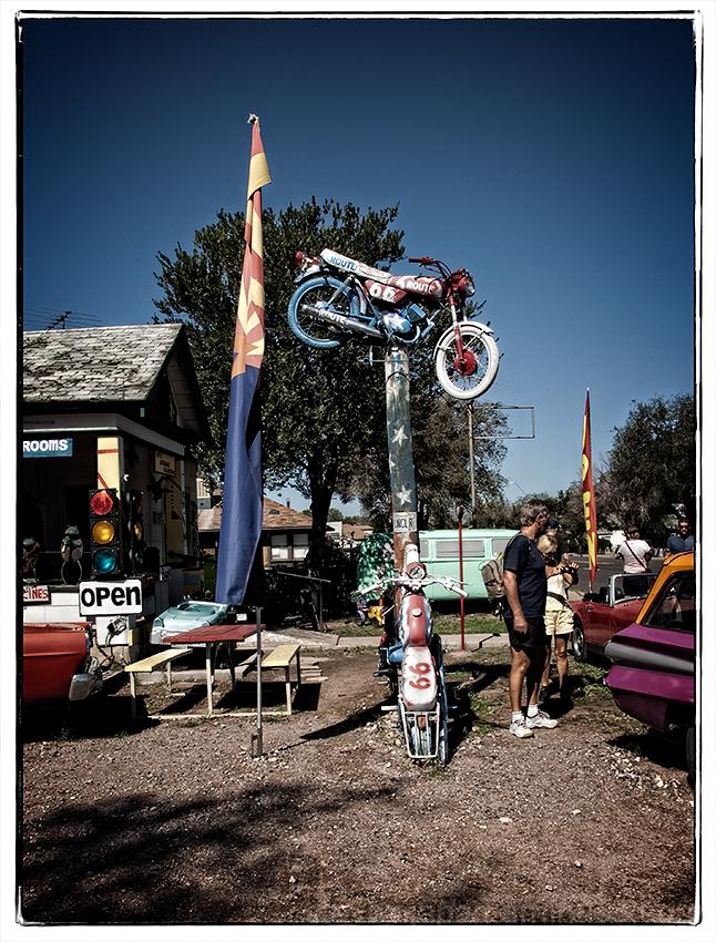 A motorcycle on a pole in Seligman, AZ.
