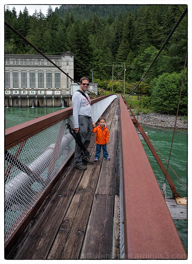 Daniel and Alex on a suspension bridge.