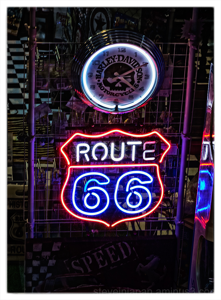 A shop window, with a Route 66 sign, in Nagasaki.