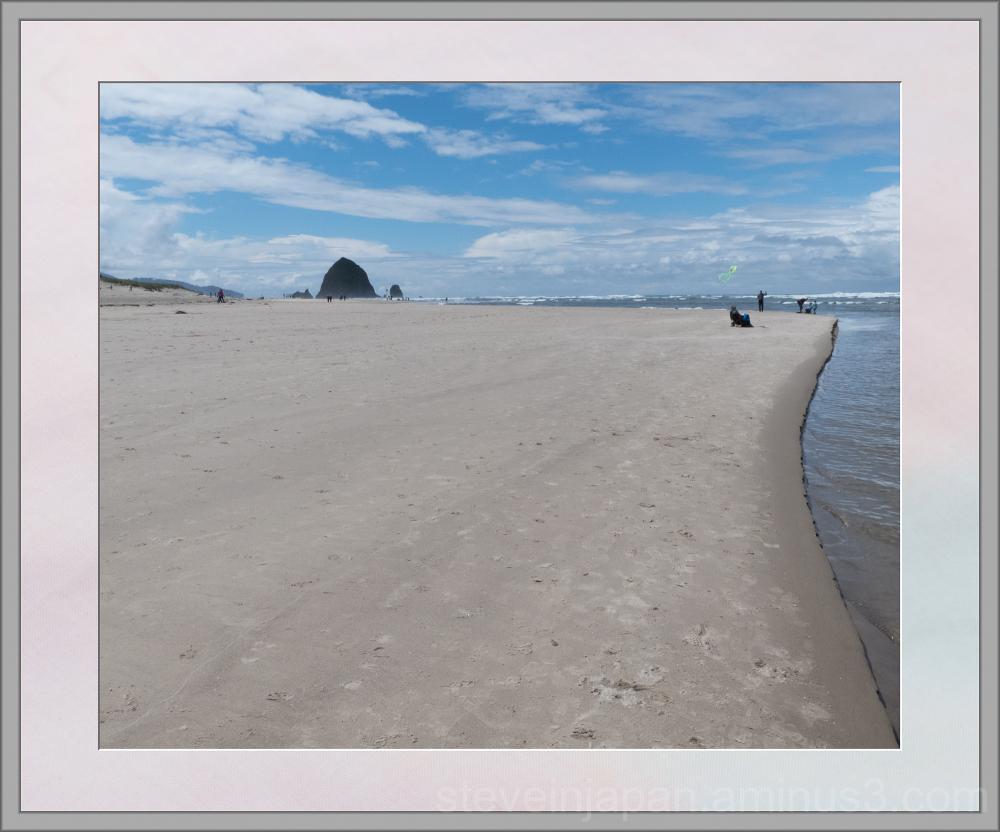 Haystack Rock down the beach.