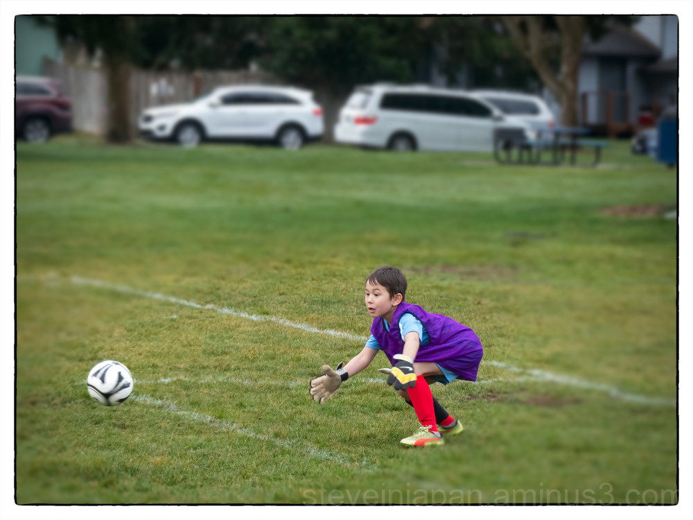 Alex playing soccer in Olympia.