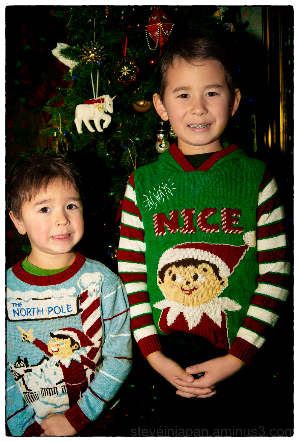 Alex and Anders by the Chistmas tree.