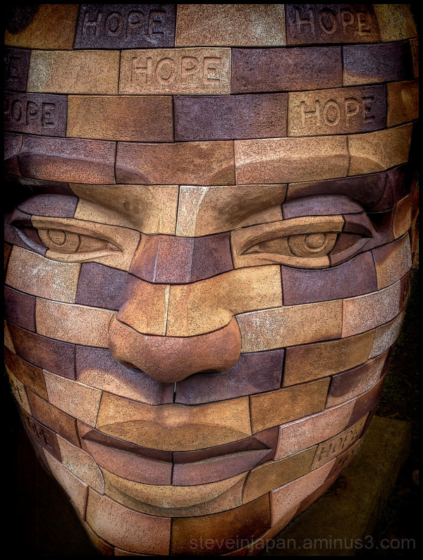 A sculpture of a head in Santa Fe.