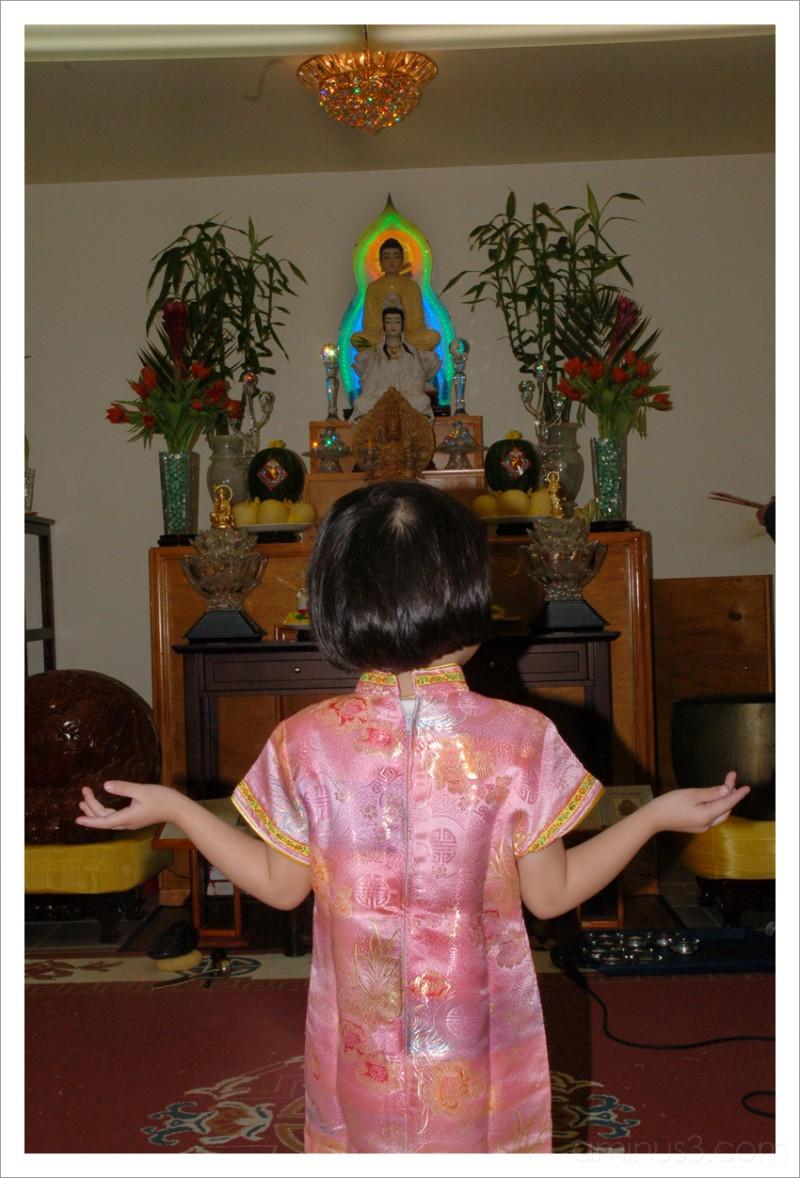Praying to Quan Am Buddha