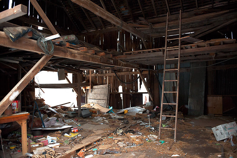 inside abandoned barn in winter