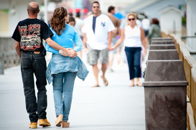 Couples strolling Point Pleasant Boardwalk NJ