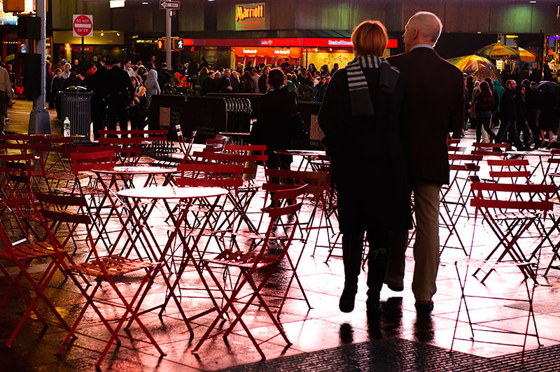 Couple walking on Broadway in the rain
