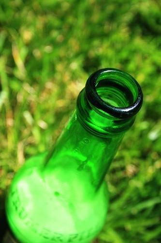 green glass on green grass bokeh