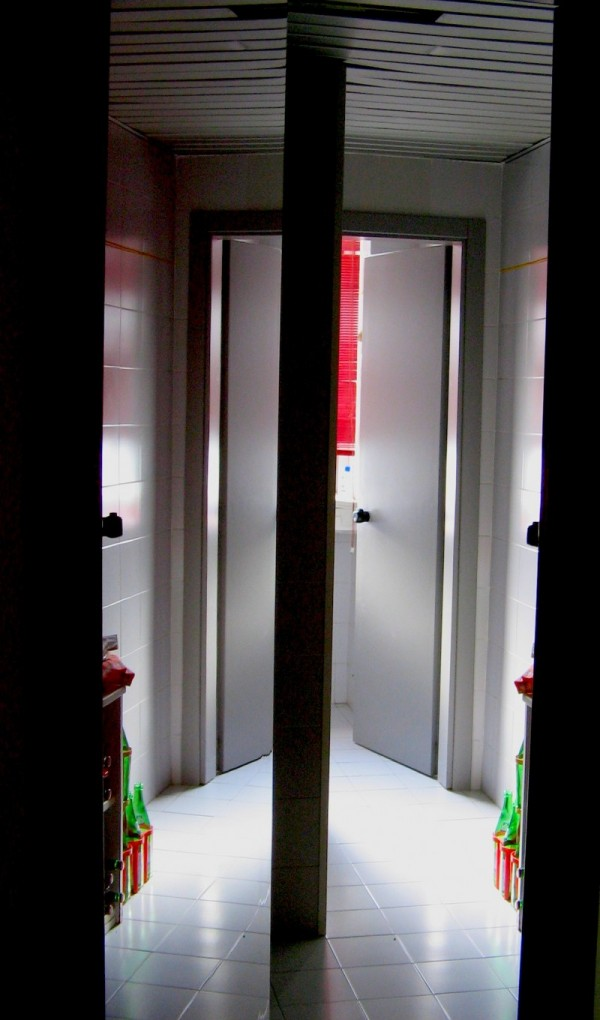 reflections off a red door