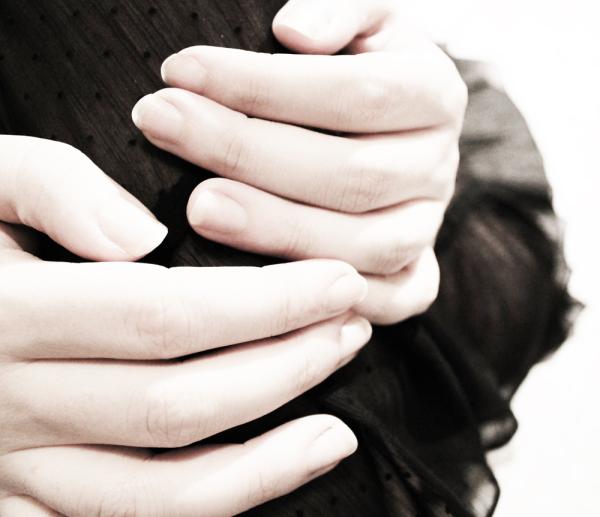 hands against black skirt