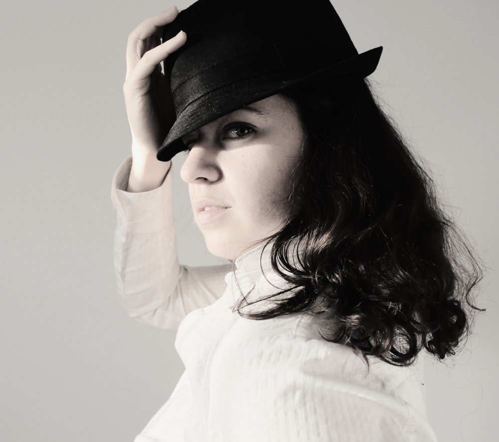 self portrait in black and white with a hat