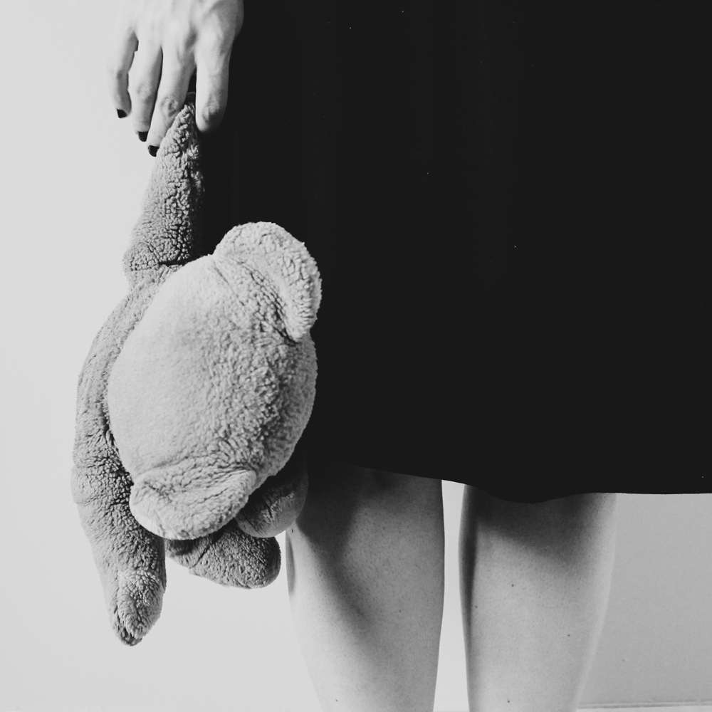 self portrait in black and white and teddy bear