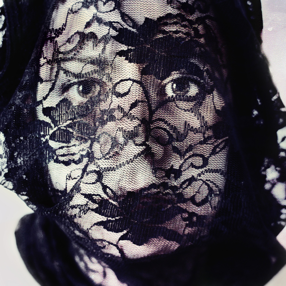 self portrait in black and white with a veil