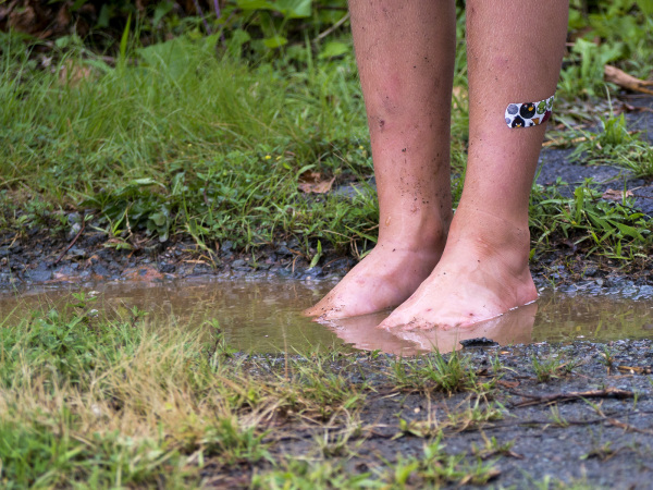 Feet in a mud puddle