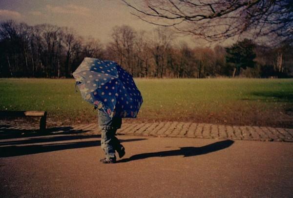 The boy with umbrella