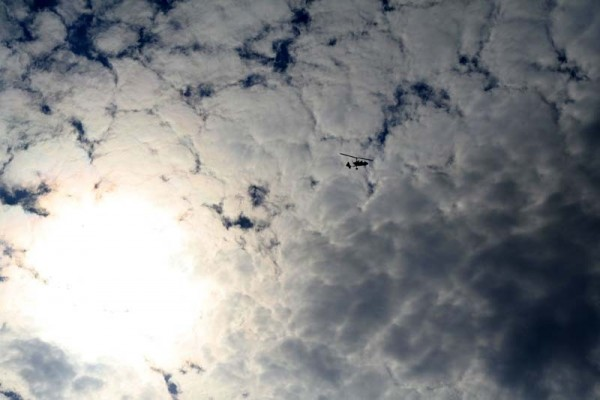 Helicopter, clouds, and sun