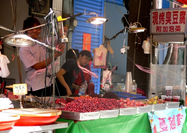 Rotating fly whisks at the fruit stand