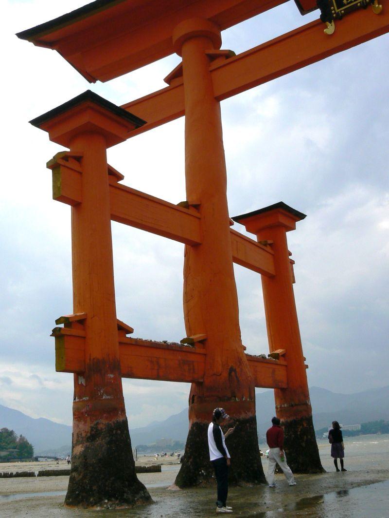 Tourists under the Toorii at Miyajima